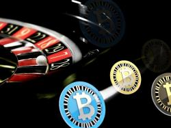 A roulette wheel with bitcoin chips